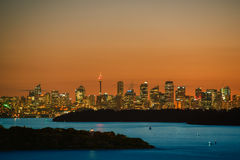 Sydney City and Sydney Harbour at sunset Stock Photography