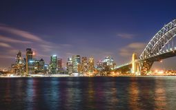 Sydney cityscape at night, reflection on harbour. stock photos