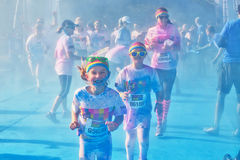 Sydney Color Run. SYDNEY,AUSTRALIA - AUGUST 24,2014: Competitors in the 'Color Run' fun run in Centennial Park. Runners are doused in coloured powder, bubbles Stock Image