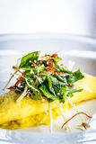 Sydney Crab Omelette, Enoki Mushroom, and Herb Salad, Miso Mustard Broth Royalty Free Stock Photo