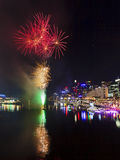 Sydney Darling Harbour Fireworks bunch. Australia Sydney Darling Harbour water reflects fireworks and city CBD lights during festive season Royalty Free Stock Images