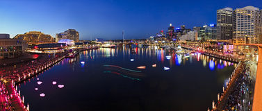Sydney Darling Harbour Sunset pan. Australia Sydney Darling harbour still blurred water of coockle bay at sunset with illuminated buildings, hotels and tourism royalty free stock photo