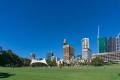 Sydney Domain, public space with CBD skyline on the background Royalty Free Stock Photos