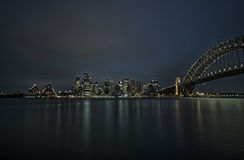Sydney downtown  with Opera House and Harbour Bridge at night, N. SW, Australia. Long exposure Stock Photos