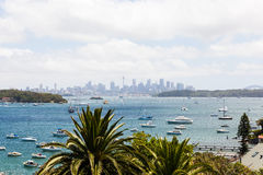 Sydney from far. The Sydney city skyline from across the bay near the entrance to the Sydney harbour mouth at Watsons bay Royalty Free Stock Image