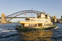 Sydney Ferry and Sydney Harbour Bridge Royalty Free Stock Image