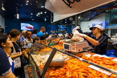 Sydney Fish market. On the day before christmas. It is very busy at the market as people scramble to buy fresh seafood for christmas day barbecues. Prawns are stock photography