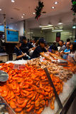 Sydney Fish market. On the day before christmas. It is very busy at the market as people scramble to buy fresh seafood for christmas day barbecues. Prawns are Royalty Free Stock Photo