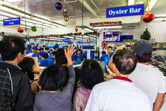 Sydney Fish market. On the day before christmas. It is very busy at the market as people scramble to buy fresh seafood for christmas day barbecues. People shout Royalty Free Stock Photos