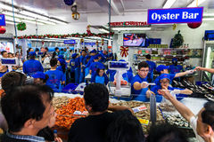 Sydney Fish market. On the day before christmas. It is very busy at the market as people scramble to buy fresh seafood for christmas day barbecues. People shout stock photo