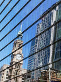Sydney GPO Clock Tower. The Sydney GPO clock tower and a modern high rise building reflected in a glass window or facade, Martin Place, Sydney, Australia. The Royalty Free Stock Photo