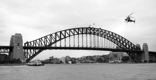 Sydney habour bridge. Sydney harbour bridge in monochrome with police helicopter flying over in preparation for the upcoming APEC meeting stock photo