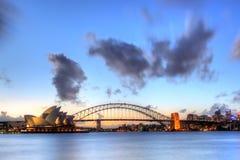 Sydney hamn med den operahuset och bron Royaltyfria Bilder