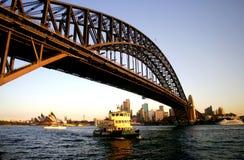 Sydney Harbor Bridge. Sydney Opera House and Harbor Bridge at sunset with ferry boat Royalty Free Stock Image
