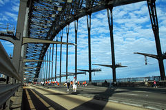 Sydney harbor bridge. People walking over harbor bridge which is closed for traffic on marathon day with blue sky and cloudscape background, Sydney, Australia Royalty Free Stock Image