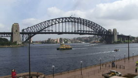 Sydney Harbor Bridge with ferry in foreground. Sydney Harbor Bridge and ferry in foreground stock footage