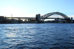 Sydney Harbor Bridge på solnedgången Arkivbild