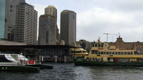 Sydney Harbor ferry pulls out of harbor terminal. Slowly stock footage