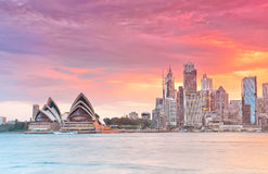 Sydney Harbor and Opera House at dusk. Sydney, Australia - January 23, 2015: Sydney Harbor and Opera House at dusk on January 23, 2015 in Sydney, Australia. The Stock Image