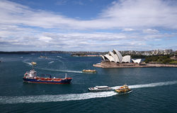 Sydney harbour Australia with opera house. Busy Sydney harbour Australia with opera house, ships and ferries royalty free stock photo