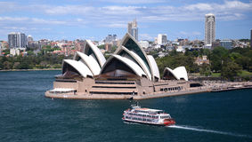 Sydney harbour Australia with opera house. With city skyline and tourist paddle ferry royalty free stock images