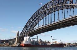 Sydney Harbour Bridge. Cargo ship passing under the Sydney Harbour Bridge Stock Images
