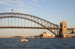 Sydney Harbour Bridge. And Opera House with a yacht cruising past, Australia Stock Image
