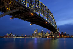 Sydney Harbour Bridge. Harbour Bridge with the Sydney skyline in the background including the world famous Opera House Royalty Free Stock Image