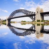 Sydney Harbour Bridge. On a beautiful sunny summer day, with a Photoshop reflection in the harbour Stock Images
