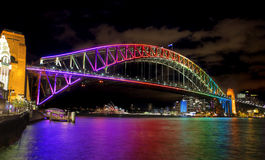 Sydney Harbour Bridge, Australia. NTH SYDNEY, AUSTRALIA - JUNE 6, 2014;  Sydney Harbour Bridge in vibrant rainbow colours during the Annual Vivid Festival, view Royalty Free Stock Photography