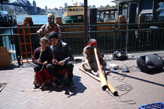 Sydney harbour bridge Australia with street entertainers Royalty Free Stock Images