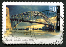 Sydney Harbour Bridge Australian Postage Stamp. AUSTRALIA - CIRCA 2004: A used postage stamp from Australia, depicting an image of Sydney Harbour Bridge in stock image