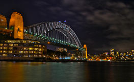 Sydney Harbour Bridge. The Sydney Harbour bridge is being illuminated during night time Royalty Free Stock Images