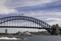 Sydney Harbour Bridge. A daytime long exposure of boats passing the famous Sydney Harbour Bridge at Circular Quay, Australia Stock Photo