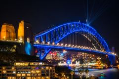 Sydney Harbour Bridge dressed in blue for Vivid. Sydney, Australia -May 25, 2018: Vivid Festival in Sydney Harbour, Australia. Close up to Sydney Harbour Bridge Royalty Free Stock Image