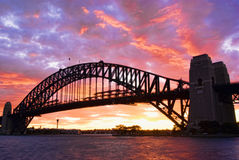 Sydney Harbour Bridge At Dusk. With firing sky in background Stock Photography