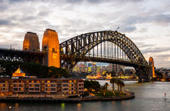 Sydney Harbour Bridge at dusk. Sydney, Australia - July 12, 2010 : Urban Scene of Sydney Harbour with the Harbour Bridge at dusk stock photo