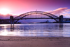 Sydney Harbour Bridge in the early morning. Sydney Harbour Bridge at sunrise, across the water Royalty Free Stock Photography