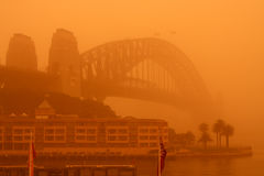 Sydney Harbour Bridge during extreme dust storm. An extreme dust storm descends on Sydney, Australia, blanketing the Sydney Harbour Bridge Royalty Free Stock Photo