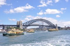 Sydney Harbour Bridge with Ferries Stock Photo