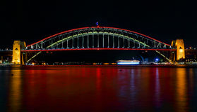 Sydney Harbour Bridge ilights in red for Vivid Sydney Festival. SYDNEY, AUSTRALIA - MAY 21, 2015;  Sydney Harbour Bridge lights up in vivid reds for Vivid Sydney Royalty Free Stock Photos