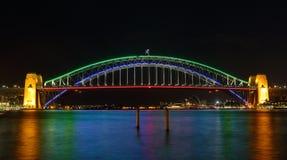 Sydney Harbour Bridge illuminated in colours for Vivid Sydney. SYDNEY, AUSTRALIA - MAY 21, 2015;  Sydney Harbour Bridge lights preview for Vivid Sydney 2015 Stock Photo