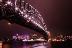 Sydney Harbour Bridge. At night with Northern Sydney skyline in the background Royalty Free Stock Image