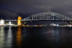 Sydney Harbour Bridge. The night view at Sydney Harbour Bridge with the Opera House in the background and the Lunapark on the left Royalty Free Stock Photo