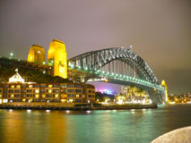 Sydney Harbour Bridge at nightime. Under a heavy leaden sky which reflects much of the light back onto the bridge Royalty Free Stock Photos