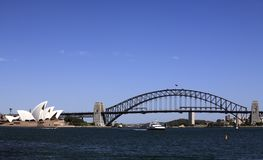 Sydney Harbour Bridge and Opera House. Are popular tourist destinations. Many tourists take a ferry ride around the harbour to view these popular landmarks Royalty Free Stock Photos