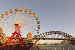 The Sydney harbour Bridge, Opera House and a large Ferris Wheel, Australia Royalty Free Stock Images