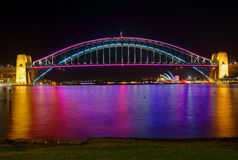Sydney Harbour Bridge and Opera House in lights. SYDNEY, AUSTRALIA - MAY 23, 2015;  The two icons, Sydney Harbour Bridge and Sydney Opera House adorned in Stock Photo