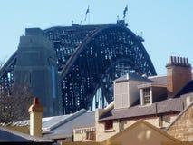 Sydney harbour bridge over rooftops. Sydney harbour bridge view over rooftops in the stock photography