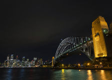 Sydney harbour bridge and skyline landmarks in australia at nigh Stock Photography